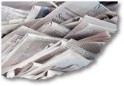 tumpukan koran berantakan